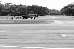 Republic of Singapore Air Force Open House 2011. Republic of Singapore Air Force Chinook heavy lift helicopter deploying light strike vehicle and commandos stock photography