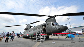 Republic of Singapore Air Force (RSAF) CH-47 Chinook twin rotors helicopter on display at Singapore Airshow Stock Photo