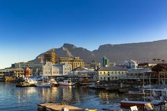 Cape Town, South Africa. Republic of South Africa. Cape Town Kaapstad. Waterfront - Victoria Basin with historical buildings. Devil`s Peak and Table Mountain in royalty free stock photos