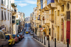 Republic Street in the morning, Valletta. VALLETTA, MALTA - MARCH 6 2017: Famous Republic Street with traditional maltese balconies and buildings Stock Photos