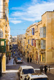 Republic Street in the morning, Valletta. VALLETTA, MALTA - MARCH 6 2017: Famous Republic Street with traditional maltese balconies and buildings Royalty Free Stock Photo