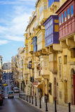 Republic Street in the morning, Valletta. VALLETTA, MALTA - MARCH 6 2017: Famous Republic Street with traditional maltese balconies and buildings Stock Image