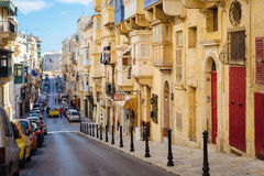 Republic Street in the morning, Valletta. VALLETTA, MALTA - MARCH 6 2017: Famous Republic Street with traditional maltese balconies and buildings Stock Photo