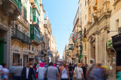 Republic Street with a moving crowd in the old town of Valletta, Malta. Stock Photo