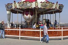 Republic of Tatarstan, Kazan, may 3, 2018, children ride on carousels, editorial royalty free stock images