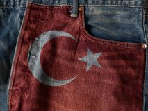 Republic of Turkey flag On Jeans Denim Texture. The concept of R. Epublic of Turkey national flag on denim Jeans background. Ideal for Turkey Textile Industry Or stock photography
