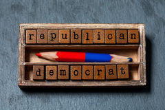 Republican democrat politic alternative choice concept. Vintage box, wooden cubes phrase with old style letters, red Stock Image