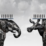 Republican Democrat. Political division concept and American election fight as as two mountain cliff sculptures shaped as an elephant and donkey symbol fighting Stock Image