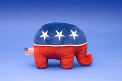 Republican party elephant. Stuffed toy Republican party mascot elephant on blue background stock image