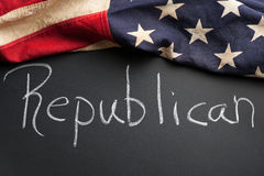 Republican sign. A Republican sign written on a chalkboard with vintage American flag royalty free stock photography