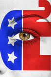 Republicans elephant painted on face to support elections. Republicans elephant painted on female  face to support elections Royalty Free Stock Image