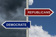 Republicans versus Democrats. Signs with two types of skies showing the opposite Royalty Free Stock Image