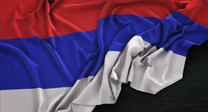 Republika Srpska Flagge knitterte auf dunklem Hintergrund 3D übertragen Lizenzfreie Stockbilder