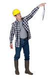 Repulsed tradesman dangling a clipboard Stock Photos
