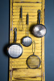 Repurposed shutter organizer. A  kitchen organizer made from repurposed house shutters Stock Photos