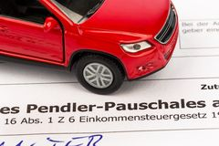 Request for commuter tax. An application for the commuter tax with a red car model stock photos