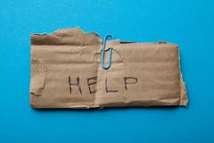 Request for help on old cardboard, donation stock image