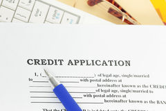 Request for Loan. Credit with blank form and ballpen Royalty Free Stock Photography