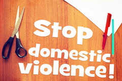 Request to stop domestic violence. Conceptual image with scrapbooking stock image