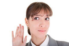 Requests listen. Woman in business clothing listen on white Royalty Free Stock Images