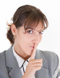 Requests silence. Woman in business clothing requests to keep quiet Royalty Free Stock Photo