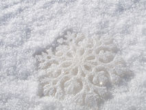 Rerecreation snowflake. In white snow Stock Images