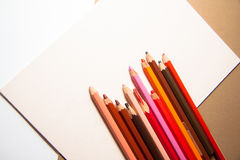 Rerto background with pencils and color paper with copy space Royalty Free Stock Photo