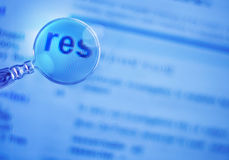 Res on a blue background with a magnifier Stock Images