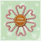 Res christmas candy canes in hearts and snowflake shapes. With red striped ribbon and cookie with Merry Christmas text on vintage background. Vector Christmas Royalty Free Stock Photo