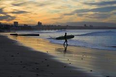 Resaca de la puesta del sol Imagenes de archivo