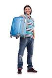 Resande för ung man med isolerade resväskor Arkivbild