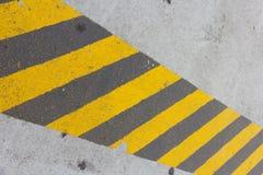 Resbalón de la tira en piso concreto Foto de archivo libre de regalías