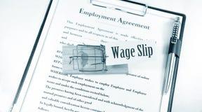 Resbalón del salario imagen de archivo