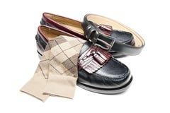 Resbalón negro en los zapatos de alineada imagen de archivo libre de regalías