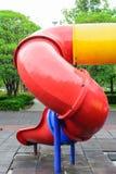 Resbalador colorido del patio Imágenes de archivo libres de regalías