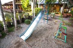 Resbalador en el parque de los niños Fotos de archivo