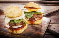 Resbaladores de la hamburguesa Fotografía de archivo libre de regalías