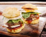 Resbaladores de la hamburguesa Foto de archivo