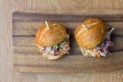 Resbaladores de la hamburguesa Foto de archivo libre de regalías