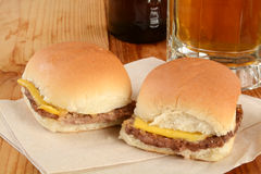 Resbaladores del cheeseburger Imagen de archivo libre de regalías