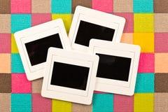 Resbale la película en tela colorida Fotos de archivo libres de regalías