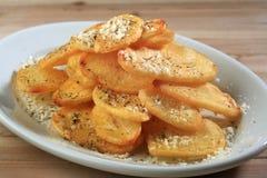 Resbale las patatas fritas Fotos de archivo