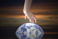 Rescate la tierra Foto de archivo libre de regalías