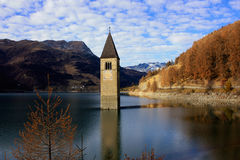 Reschensee tower in the South Tyrol, Italy. Royalty Free Stock Images