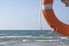 Rescue. Photo of a quarter of a lifebuoy with sea in the background Royalty Free Stock Images