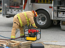 Rescue # 5. Fireman cutting into a wrecked car to remove the driver Royalty Free Stock Photo