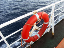 Rescue. The red lifesaving circle on deck Stock Photos