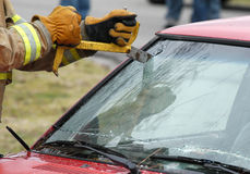 Rescue # 7. Fireman cutting into a wrecked car to remove the driver Stock Image