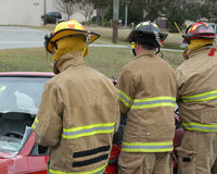 Rescue # 9. Fireman cutting into a wrecked car to remove the driver Royalty Free Stock Photos