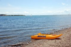 Rescue boat. Yellow rescue boat on the lake beach Royalty Free Stock Image